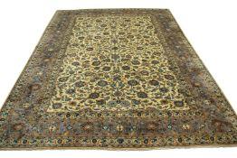 Good quality modern Keshan large carpet, multi-gull border, central panel of flowering foliage,