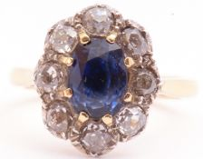 Sapphire and diamond cluster ring, the oval cut sapphire multi-claw set with 8 old cut diamond