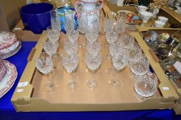 BOX OF CUT GLASS WINE GLASSES AND FLUTES