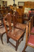PAIR OF CHIPPENDALE STYLE OAK DINING CHAIRS WITH PIERCED SPLAT BACKS AND SOLID SEATS