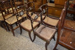 SET OF FOUR REGENCY STYLE CANE SEAT DINING CHAIRS WITH SABRE LEGS (ONE A/F)