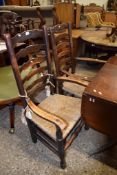 TWO 19TH CENTURY LANCASHIRE STYLE LADDERBACK CARVER CHAIRS WITH RUSH SEATS