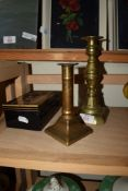 TWO BRASS CANDLESTICKS AND MONEY BOX