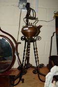 COPPER KETTLE ON A WROUGHT METAL STAND