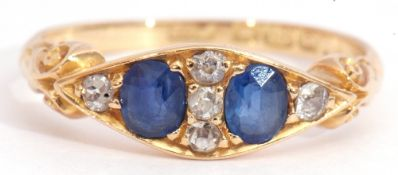 Early 20th century 18ct gold sapphire and diamond ring, featuring two old faceted sapphires,