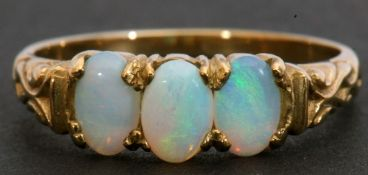 9ct gold and opalescent three-stone ring, featuring three oval cabochon opalescents, individually