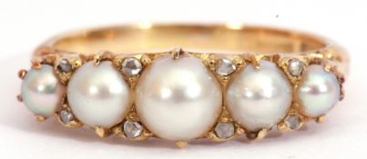 Victorian 18ct gold, pearl and diamond ring, a design featuring five cultured pearls, highlighted