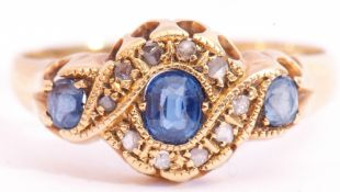 Edwardian 18ct gold sapphire and diamond ring, the prinicipal sapphire 4.4mm x 3.7mm, pale blue