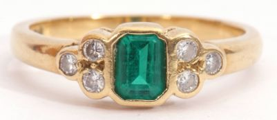 Modern 18ct gold, green stone and diamond ring, rectangular faceted cut green stone flanked by three