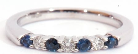 Modern sapphire and diamond ring, alternate set with four round cut sapphires and three round