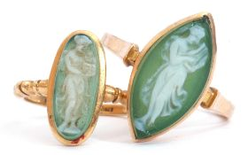 Two glass cameo rings, a green and white glass cameo depicting a lady holding a baby, each in a