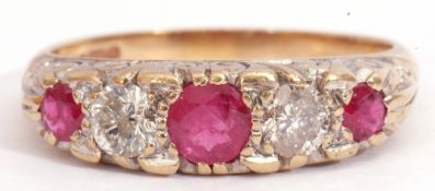 9ct gold ruby and diamond ring, having three round cut graduated rubies and two brilliant cut