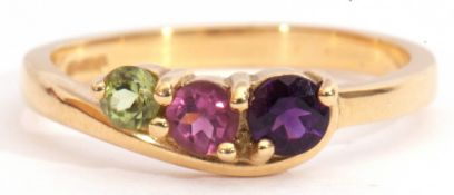 18ct gold gem set ring, a stylised design with graduated round cut amethyst, tourmaline, and
