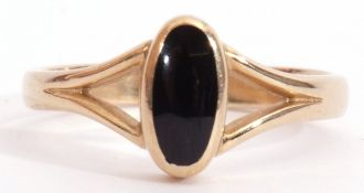 9ct gold and onyx ring, the oval shaped onyx panel in rub-over setting and raised between pierced