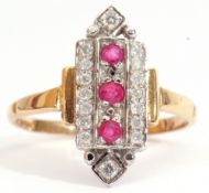 Modern Art Deco style ruby and diamond cluster ring, featuring three round cut rubies surrounded