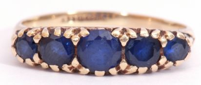Vintage 9ct gold five stone sapphire ring, featuring five round cut faceted graduated sapphires,