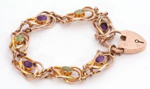 9ct gold amethyst and peridot set bracelet featuring seven open work scroll links, four with oval