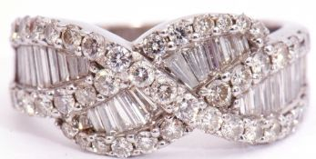 Precious metal diamond cluster ring, a design featuring pave set baguette diamonds, overlapping