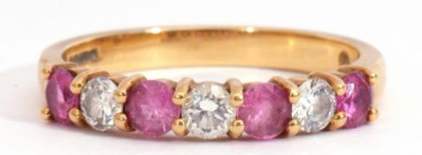 18ct gold ruby and diamond half-hoop ring set with four round pink rubies, interspersed with three