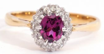 18ct gold amethyst and diamond cluster ring, the oval faceted amethyst multi-claw set and raised