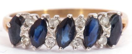 9ct gold sapphire and diamond ring, having 5 off-set lozenge shaped sapphires highlighted between