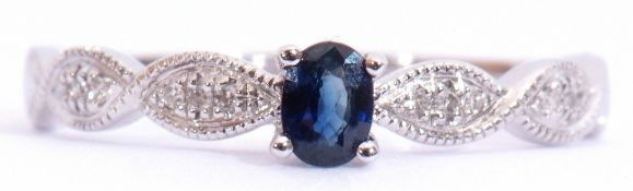 Modern sapphire and diamond ring centring an oval faceted sapphire, raised above diamond set plaited