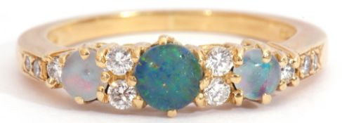18ct gold, opal and diamond ring, featuring three graduated round cut opals, interspersed by ten