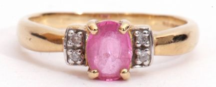 18ct gold pink tourmaline and diamond ring, the oval faceted shaped tourmaline four claw set and
