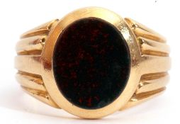 Antique gent's ring set with an oval cut bloodstone panel in rub-over setting, raised between