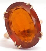 Vintage cognac coloured citrine dress ring, an oval faceted citrine, double claw set in a basket