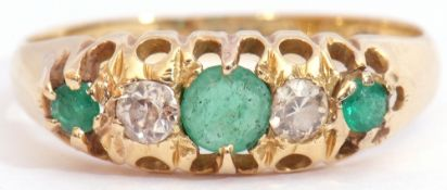 Antique emerald and diamond ring with three graduated round cut emeralds and two round old cut