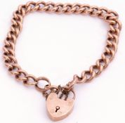 Antique 9ct rose gold curb link bracelet, heart padlock and safety chain fitting, 12.7gms