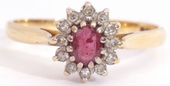 Ruby and diamond cluster ring, featuring an oval faceted small ruby, multi-claw set and raised