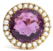 Large amethyst and seed pearl dress ring, the round cut amethyst, 14mm diam, set within a surround