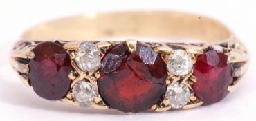 Antique garnet and diamond ring, having three graduated oval faceted garnets (centre stone cracked),