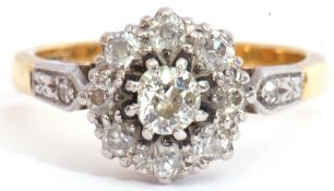 Diamond cluster ring centring an oval cut diamond of 0.20ct approx, raised within a diamond set