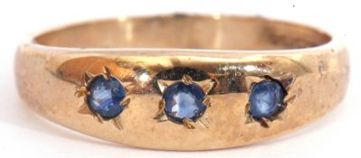 9ct gold sapphire three stone ring, the plain polished design featuring 3 round cut sapphires,