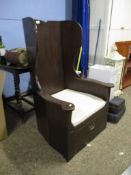 "REPRODUCTION DARK STAINED ""LAMBING"" CHAIR WITH WING BACK, SOLID SEAT AND FRIEZE DRAWER, 76CM WIDE"