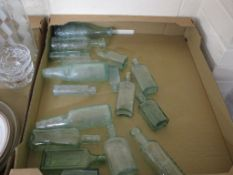 TRAY CONTAINING GREEN GLASS BOTTLES