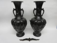 Pair of Japanese bronzed vases, early 20th century, decorated in relief with prunus and birds, the