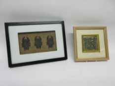Group of three carved wooden heads mounted on hessian type backing in black wooden frame, together