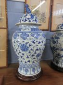 Chinese porcelain jar and cover, the baluster body decorated with floral design, the cover also with