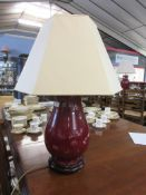 Chinese sang de beouf baluster vase on wooden base, converted to a lamp