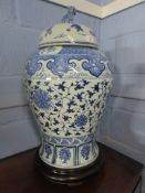 Large Chinese porcelain jar and cover, the baluster body decorated with a floral design, the cover