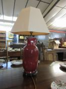 Chinese sang de beouf vase on wooden base converted to a table lamp