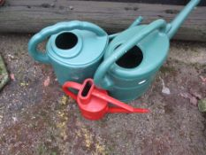 THREE PLASTIC WATERING CANS