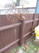 PAIR OF METAL GARDEN ORNAMENTS OF A BALL ON STICK, HEIGHT APPROX 160CM