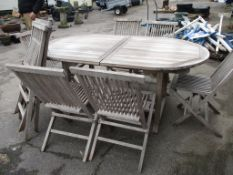 OVAL WOODEN EXTENDING PATIO TABLE AND SET OF 8 FOLDING CHAIRS, TABLE APPROX 182CM
