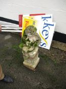 FIGURE OF A CHERUB ATOP A PLINTH, TOTAL HEIGHT APPROX 79CM