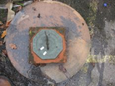 SUNDIAL MOUNTED ON TERRACOTTA TOGETHER WITH A MOULDED TABLE TOP, WIDTH APPROX 59CM